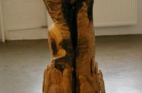 Das erste Selbstbildnis, Skulptur aus Holz
